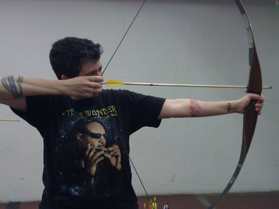 Kathleen shooting a bow and arrow