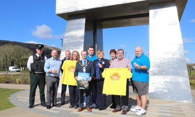 Mayor of Antrim and Newtownabbey, Councillor Paul Hamill is joined by Mr John Scott, representatives from FOCUS, Tesco employees, Stephen Moore from PSNI and Council representatives at V36, Newtownabbey to launch this year's Darkness into Light.