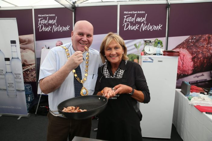 Mayor Paul Reid at Mid and East Antrim Borough Council's Food Network stand alongside chef Jenny
