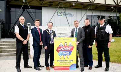 The Mayor, Councillor Paul Hamill, launches the upcoming job fair with Stephen O'Neill (Translink), Stephen McGlew (DfC), Ryan Forsythe (John Mulholland Motors), Glen Young (Hendersons) and Sgt Stephen Moore (Community Planning, Antrim and Newtownabbey).