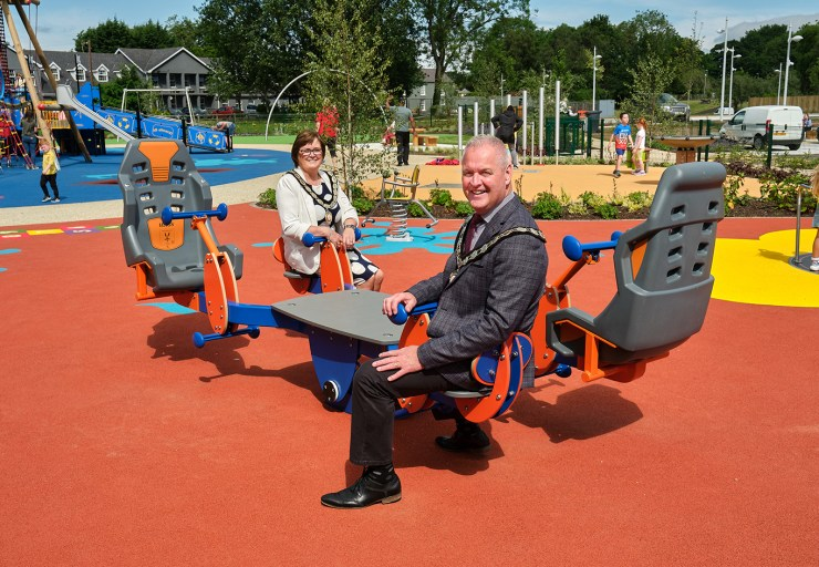 Chair of Mid Ulster District Council, Councillor Paul McLean, and Deputy Chair of Mid Ulster District Council, Councillor Christine McFlynn, try out some of the new equipment at the refurbished all inclusive play area at Ballyronan Marina.