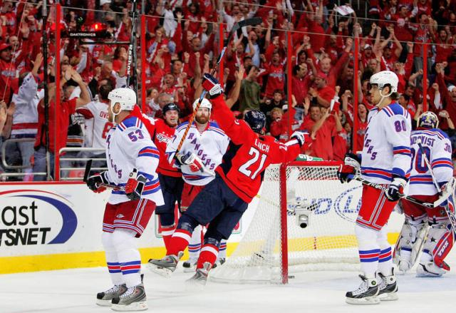 WASHINGTON - APRIL 24: Brooks Laich #21 of the Washington Capitals celebrates the second goal of the first period against members of the New York Rangers during Game Five of the Eastern Conference Quarterfinal Round of the 2009 Stanley Cup Playoffs on April 24, 2009 at the Verizon Center in Washington, DC. (Photo by Len Redkoles/Getty Images)