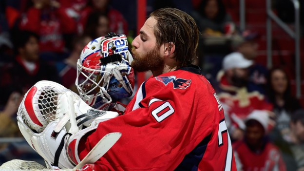 WASHINGTON, DC - JANUARY 12: Braden Holtby #70 of the Washington Capitals kisses his mask before the start of an NHL game against the Colorado Avalanche at Verizon Center on January 12, 2015 in Washington, DC. (Photo by Patrick McDermott/NHLI via Getty Images)