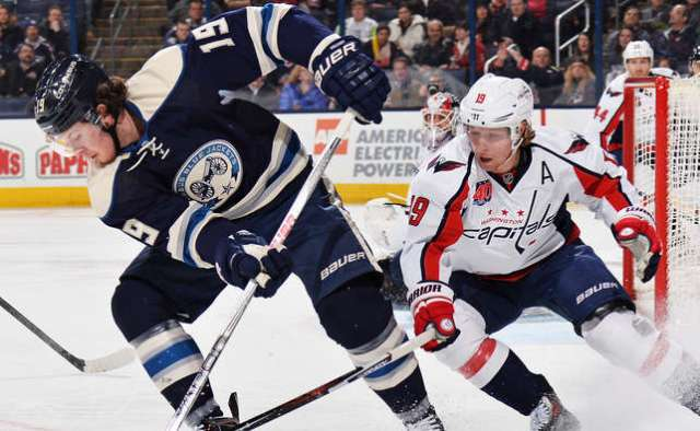 COLUMBUS, OH - MARCH 3: Ryan Johansen #19 of the Columbus Blue Jackets and Nicklas Backstrom #19 of the Washington Capitals battle for a loose puck during the first period on March 3, 2015 at Nationwide Arena in Columbus, Ohio. (Photo by Jamie Sabau/NHLI via Getty Images)
