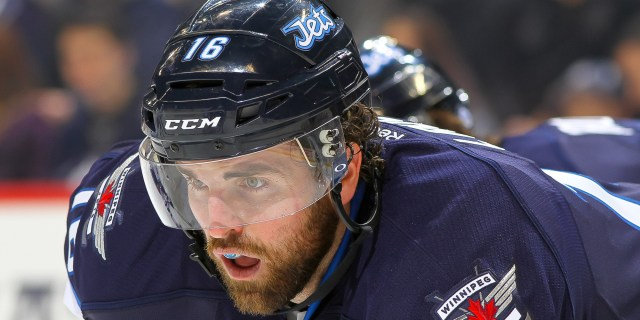 WINNIPEG, MB - MARCH 12: Andrew Ladd #16 of the Winnipeg Jets looks on during first period action against the Vancouver Canucks at the MTS Centre on March 12, 2014 in Winnipeg, Manitoba, Canada. The Canucks defeated the Jets 3-2 in the shootout. (Photo by Jonathan Kozub/NHLI via Getty Images)