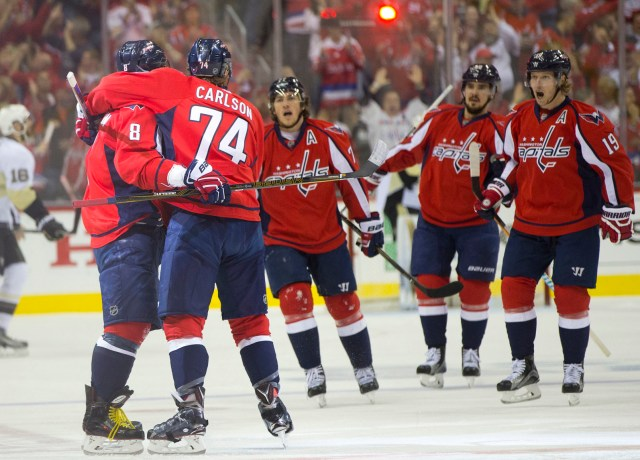 Washington Capitals left wing Alex Ovechkin (8) is congratulated by teammate John Carlson (74) and others as they celebrate Ovechkin's goal against the Pittsburgh Penguins during the first period of Game 5 in an NHL hockey Stanley Cup Eastern Conference semifinals Saturday, May 7, 2016 in Washington. (AP Photo/Pablo Martinez Monsivais)