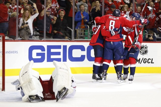 Oct 30, 2015; Washington, DC, USA; Washington Capitals right wing T.J. Oshie (77) celebrates with teammates after scoring a goal against Columbus Blue Jackets goalie Sergei Bobrovsky (72) in the third period at Verizon Center. The Capitals won 2-1. Mandatory Credit: Geoff Burke-USA TODAY Sports