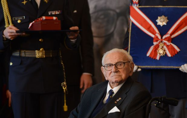 Britian Sir Nicholas Winton receives the Order of the White Lion at Prague Castle on October 28, 2014 during the celebration of the Independance day. Sir Nicholas Winton, who saved hundreds of Jewish children in Prague from the Nazis before World War II, received the Czech Republic's top honour from the president. AFP PHOTO / MICHAL CIZEK