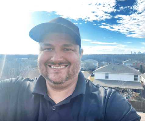 Photo of Brandon Vines the founder of Novarum Roofing, the best Texas roofer, on a roof.