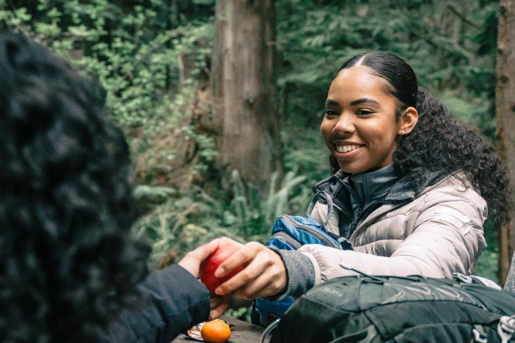 Photo of girl sharing an apple, by PNW Productions, via Pexels.