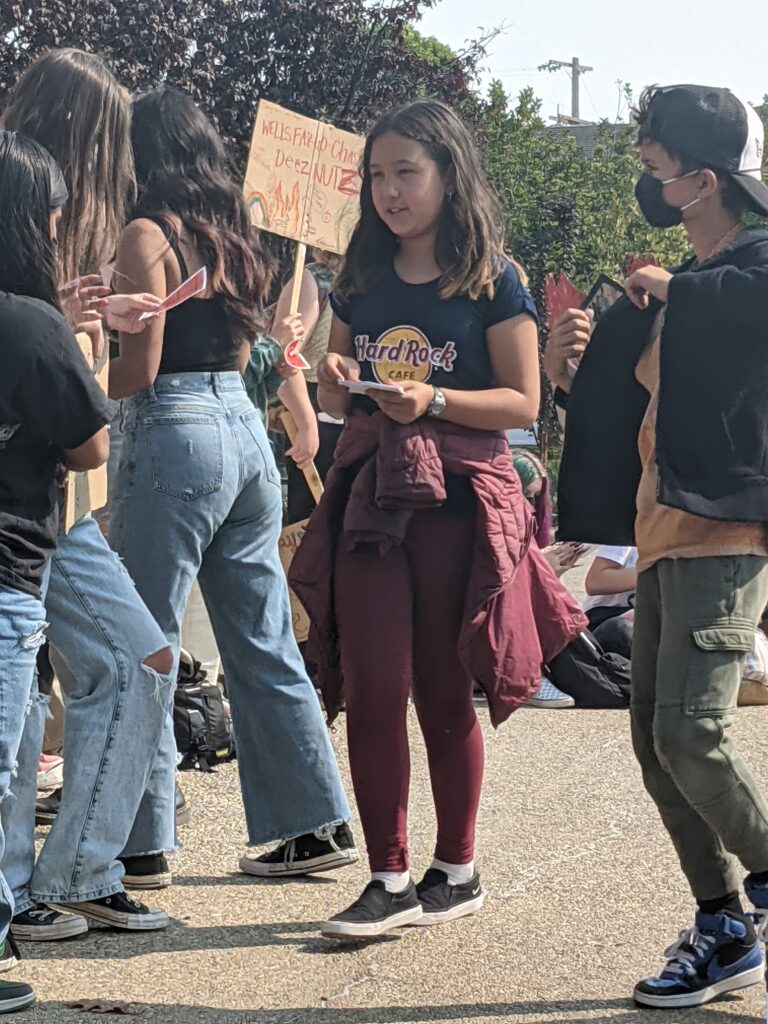 Youth for Climate Justice action 9-24: Emunah Minami passing out literature at Chase