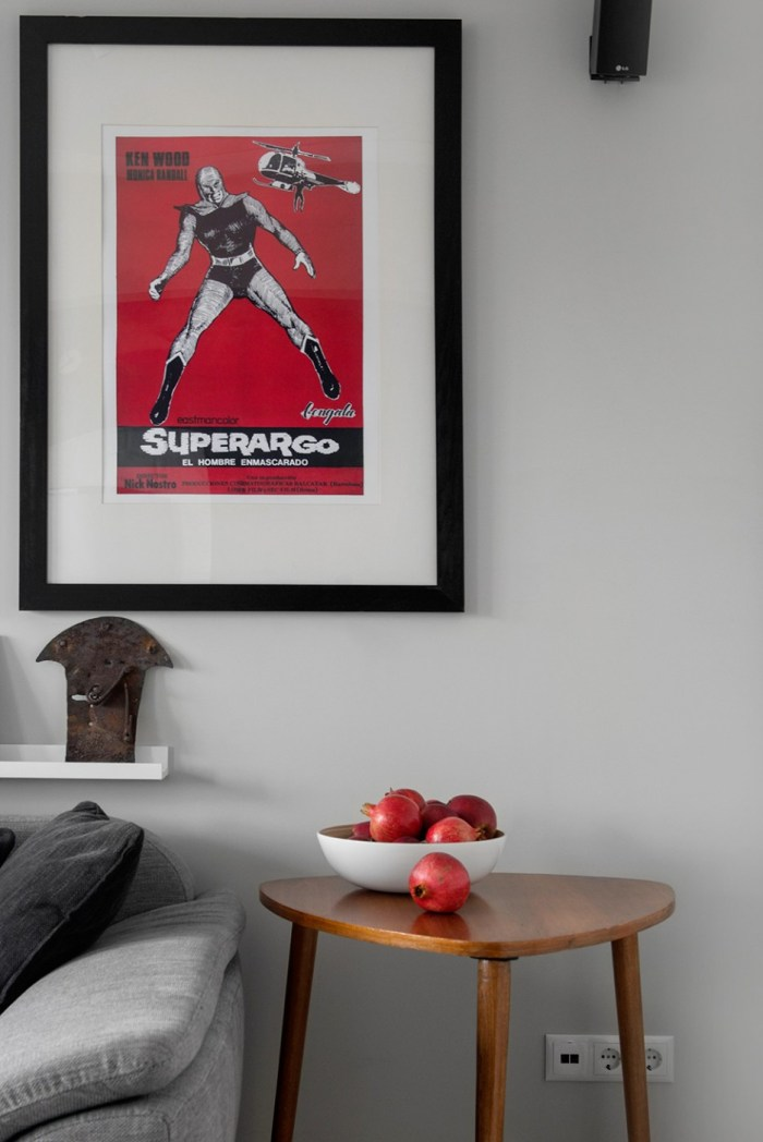 Eye-Catching-Red-Superheroes-Wall-Art-Design-to-Match-Some-Red-Fruits-on-the-Wooden-Sideboard-at-Living-Room-Beside-Fabric-Sofa-936x1402
