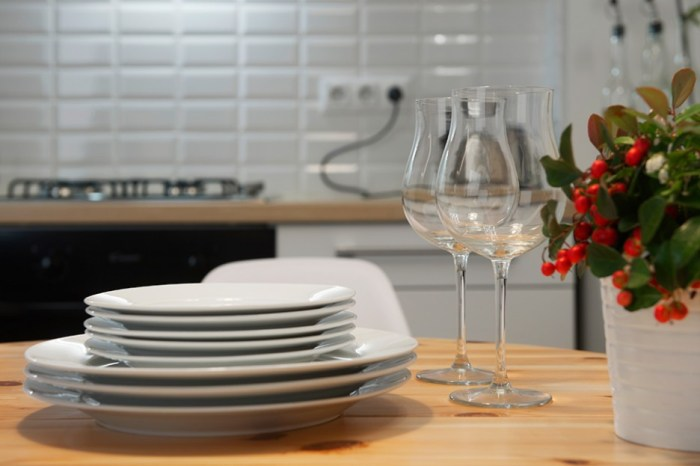 Neat-Arrangement-of-Dishes-and-Wine-Glasses-in-Hygienic-Kitchen-Area-Showing-Floral-Vase-on-Light-Wood-Kitchen-Table-Ideas-936x624