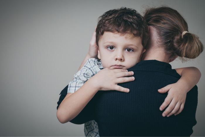 adult comforting child