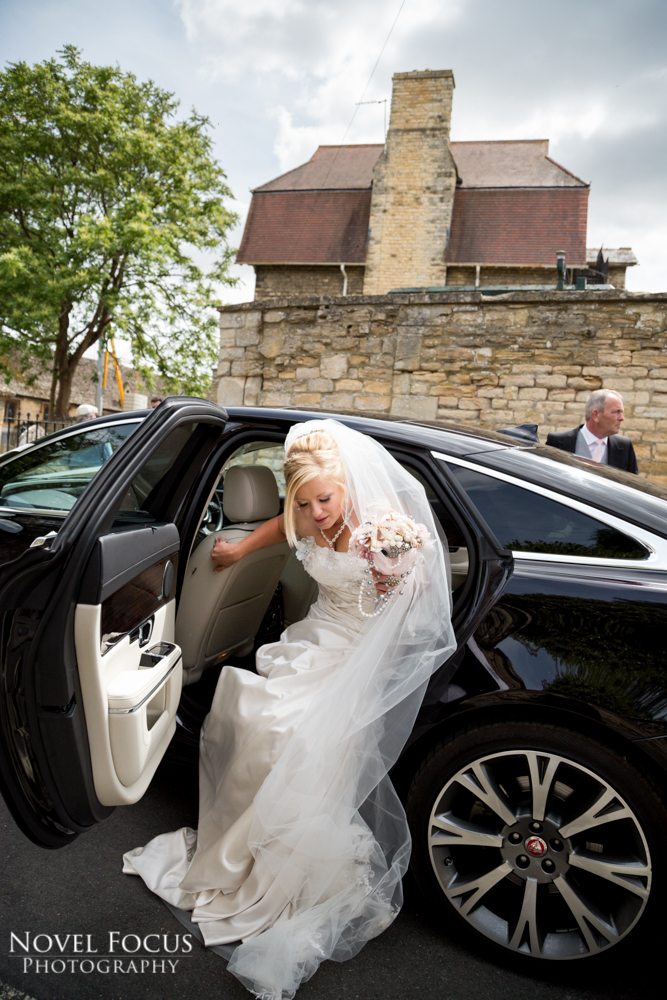 bride with wedding car