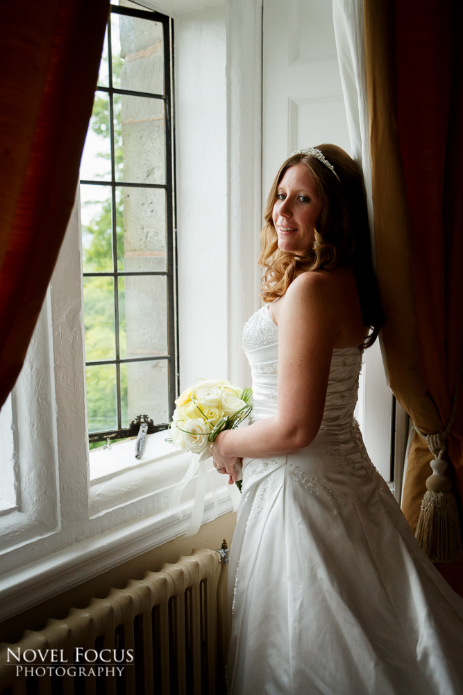 bride near window at clearwell castle