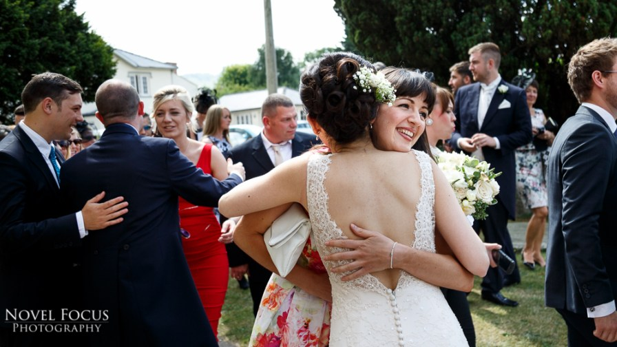 friends embracing at wedding