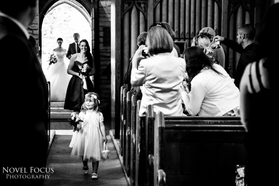 flower girl walking down aisle at wedding