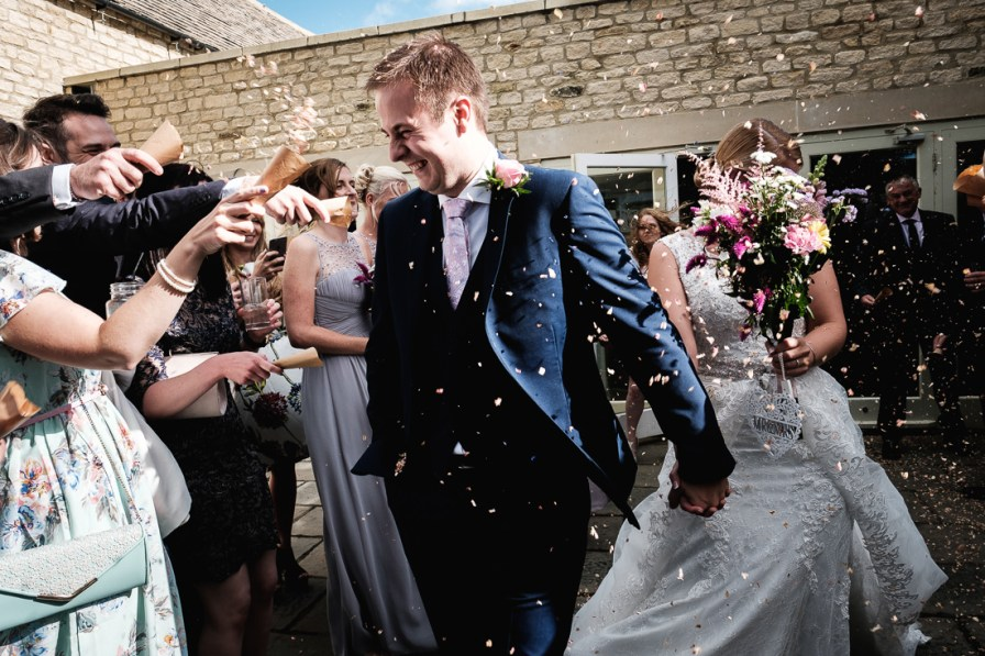 confetti from hyde barn with bride and groom