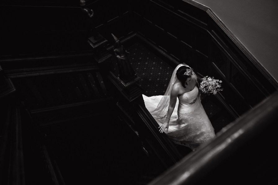 bride walking down staircase