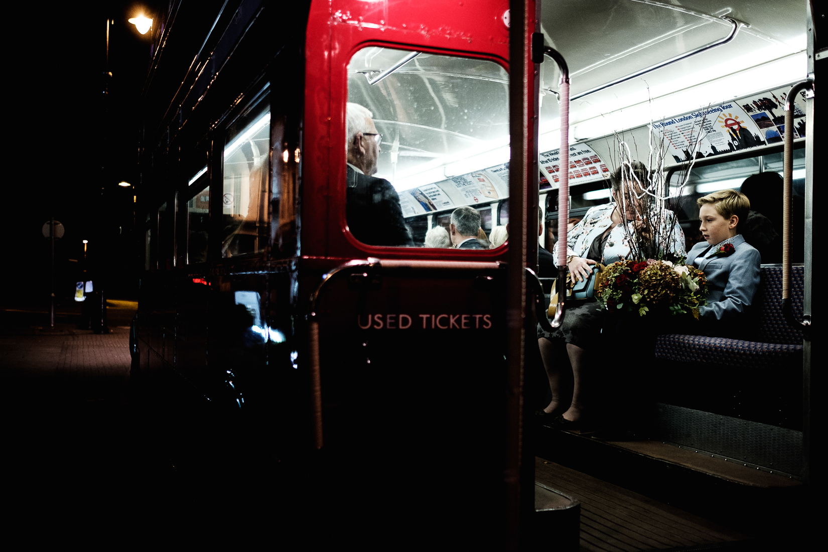 boy sat on london bus centrepiece cheltenham reportage