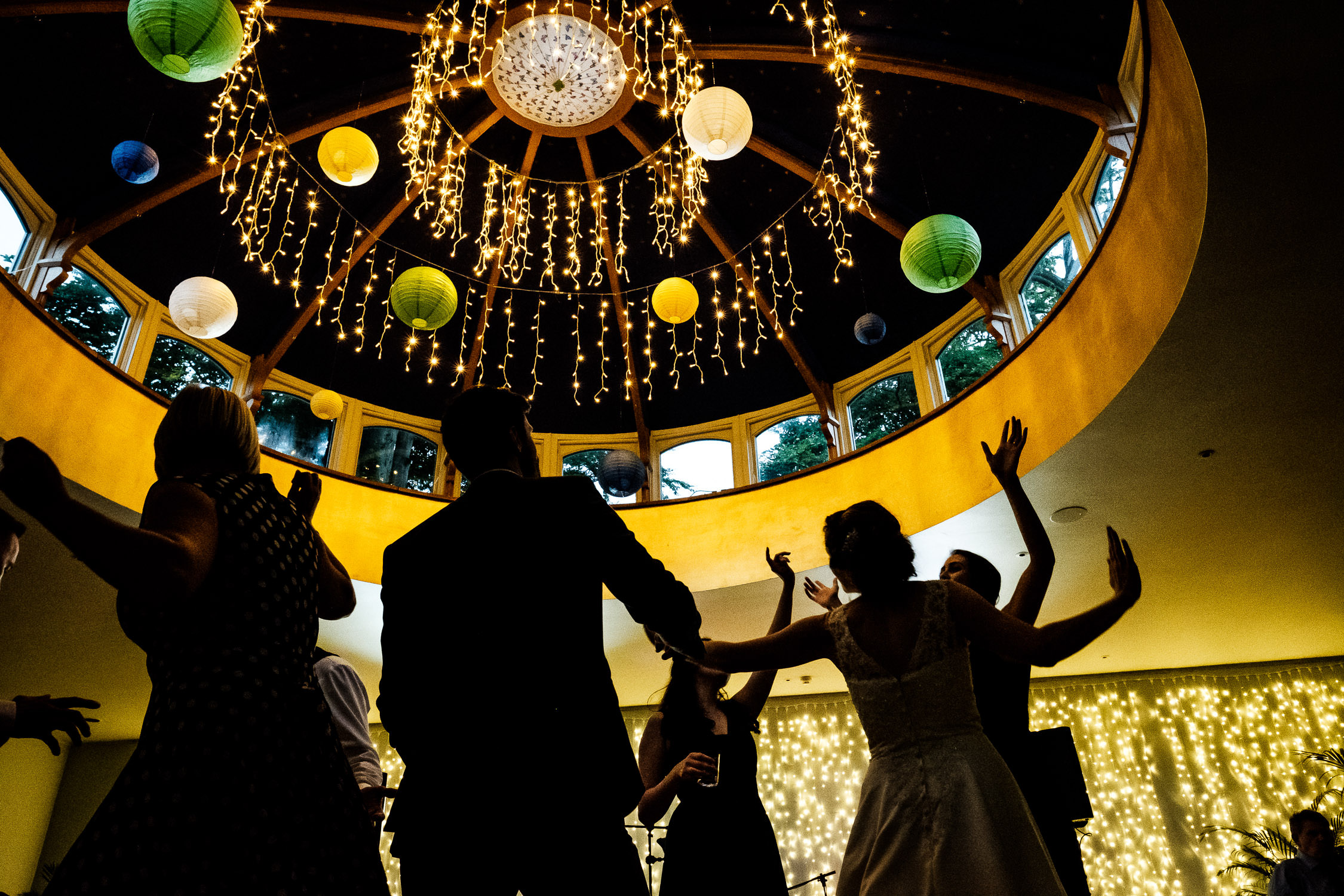 silhouette photograph of guests dancing at matara centre