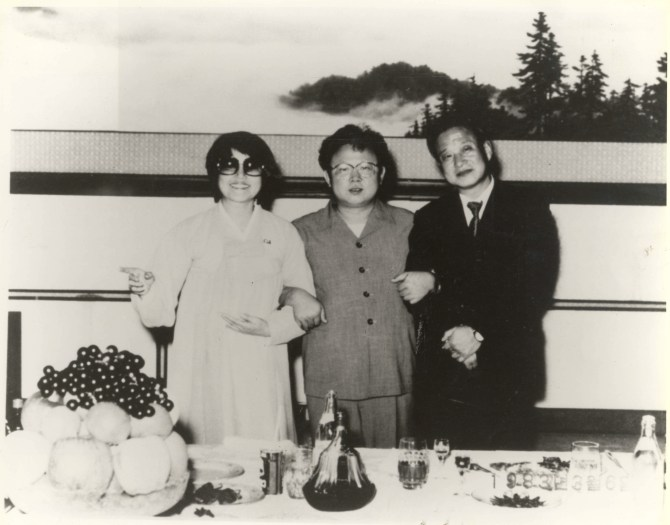 Kim Jong-il (centre) with Shin Sang-ok (right) and Choi Eun-hee (left). Photo courtesy of Magnolia Pictures.