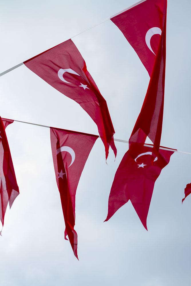 Turkish flag pendants on Taxsim Square, Istanbul, Turkey.