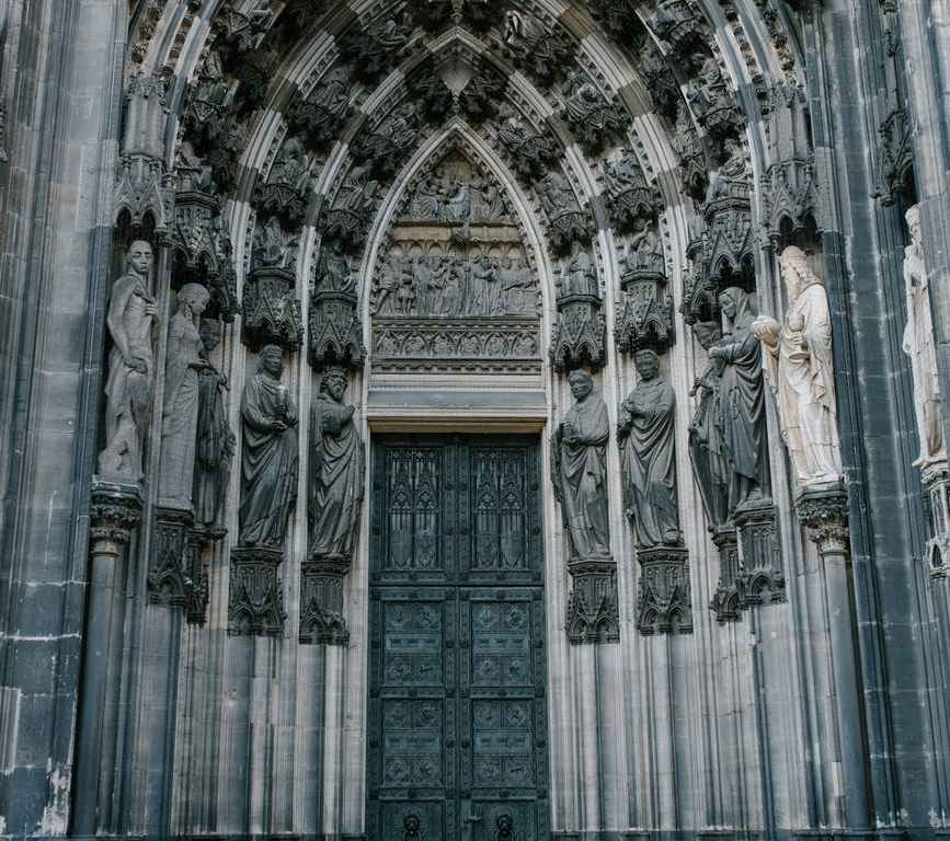 catholic cathedral door decorated with medieval statues
