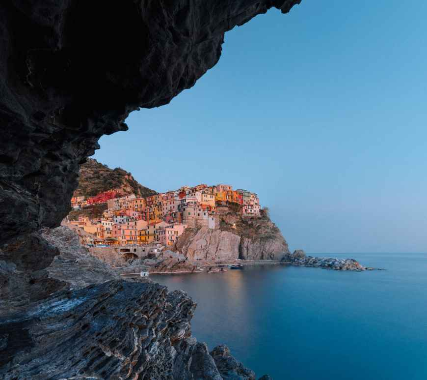 view on magnificent coastal town with colorful buildings from sea cave