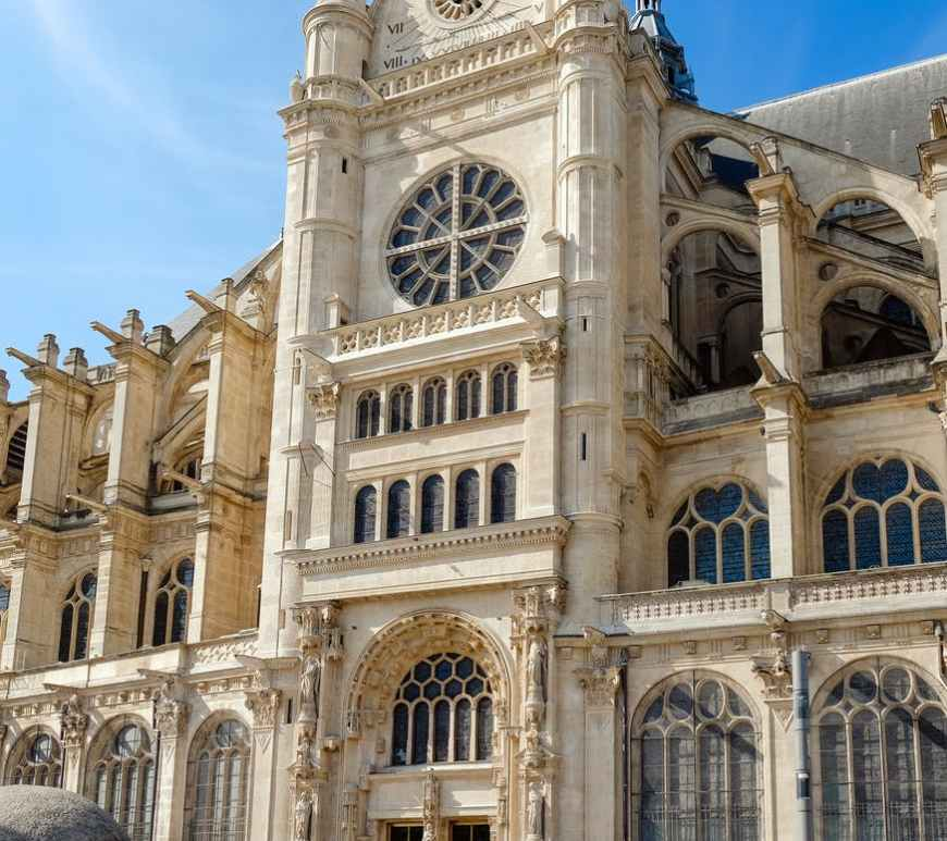 photo of people in front the saint eustache church in paris france