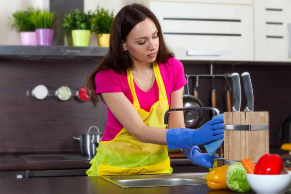 bigstock-young-woman-cleaning-kitchen-56838374-c-r