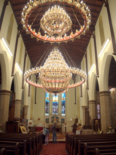Three huge chandeliers have been installed by Holy Trinity's new congregation, the Greek Orthodox Church