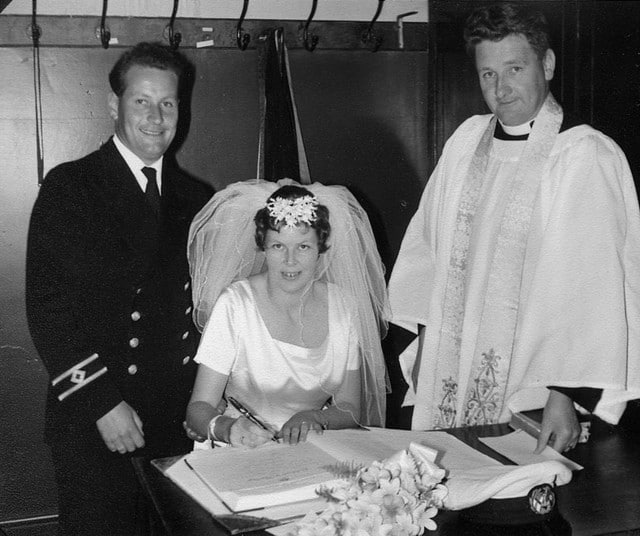 My parents signing the marriage register at Holy Trinity Church in December 1964