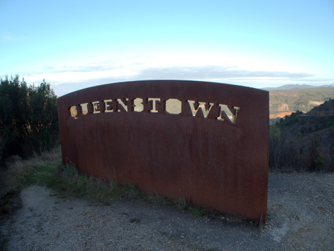 Sign at the top of the winding descent into Queenstown, on Tasmania's West Coast