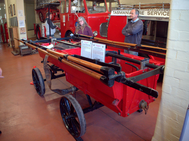 An early fire fighting vehicle was pulled and operated by convict labour. A similar vehicle, without the bright red paint job, is held in the collection at the Port Arthur Historic Site.