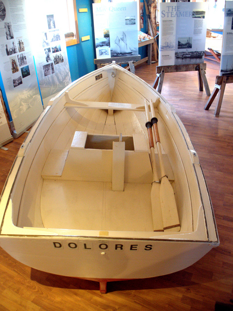 A handcrafted dinghy on display at the Wooden Boat Centre