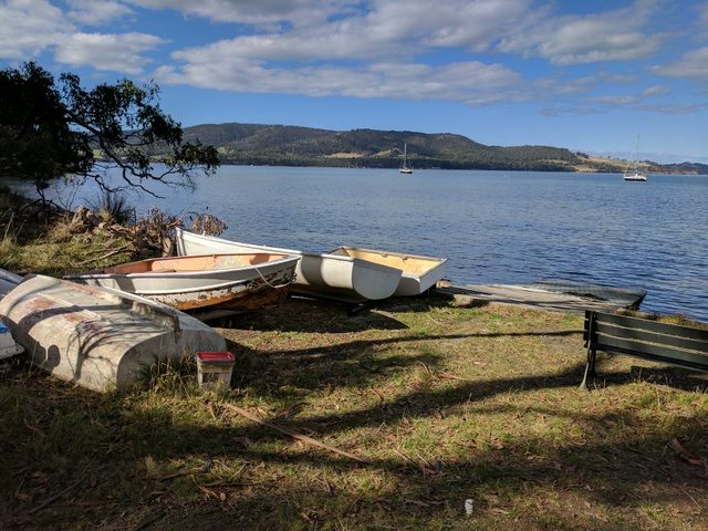 Dinghies on the foreshore along the Dave Burrows walking trail