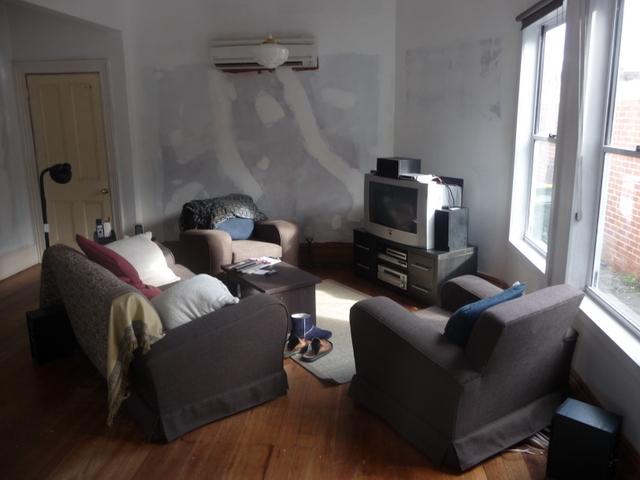 Reconfigured loungeroom. With ugg boot.