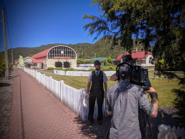 West Coast Wilderness Railway steward Tom Pavic records a piece for the video series at Queenstown Station