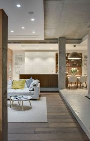 Industrial Chic: Apartment in Odessa Embraces Cozy, Space