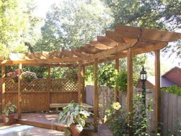 pergola curved corner wooden space patio bench garden exterior into potted hanging turn shape plants plus outdoor spaces yard refuge
