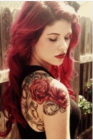 Red hair women rose tattoo on shoulder