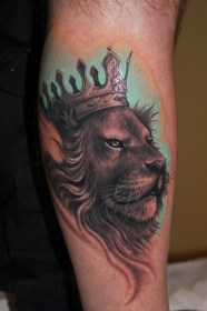 Lion with crown tattoo by Riccardo Cassese