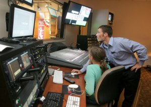 WKTV employee Nate Diedrich gives local Girl Scouts a station tour.