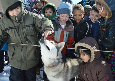 Kentwood students pet a Siberian husky
