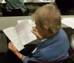 A volunteer reviews feedback from student surveys about the program.