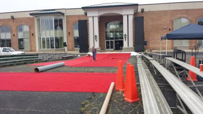 "WKTV transforms Klingman's parking lot by rolling out the red carpet in preparation for the 10th Annual Metro Cruise and WKTV's production of ""Metro Cruise LIVE on the Concourse."" Come check it out tomorrow evening. If you like lights, camera, action and classic cars -- you will love this event!"