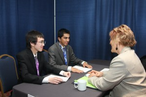 Students meet one-on-one with business professionals .