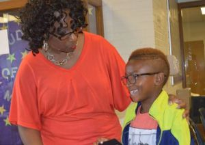 Gwenn Dangerfield meets third-grade student Cardell Harmon at registration for the new school year